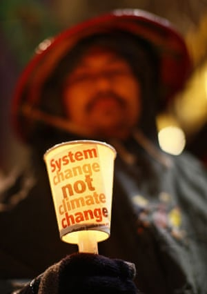 Copenhagen day 5: COP15 Activist of  La Via Campesina holds a cup with a candle