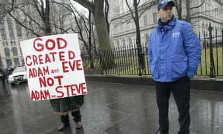 A lone protestor against gay marriage stands outside the Municipal Building in New York
