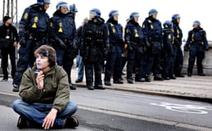 Copenhagen diary: COP15 An activist rests next to police men during a demonstration