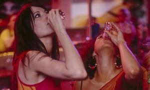 Women drinking shots at nightclub