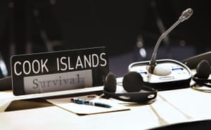 Copenhagen Diary: COP15 The sign 'survival' is placed on delegate table of the Cook Islands