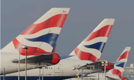 The tailfins of British Airways aircraft are seen at Heathrow Airport in west London