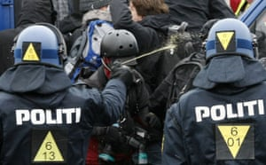COP15 Reclaim Power: A police officer sprays protesters during a demonstration  in Copenhagen