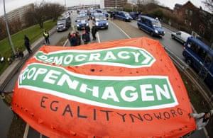 COP15 Reclaim Power: Protestors carry a banner towards Bella Center in Copenhagen