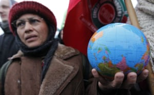 COP15 Reclaim Power: A protestor holds a globe during a demonstration in Copenhagen