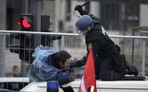 COP15 Reclaim Power: A Danish riot policeman beats a demonstrator outside the Bella Center