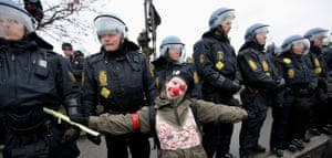 COP15 Reclaim power: A young demonstrator poses in front of a police line