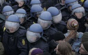 COP15 Reclaim power: The helmets of Danish riot police fog up as they push back demonstrators