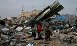 Children play in the rubble of their homes in Jabaliya, destroyed by the Israeli offensive.