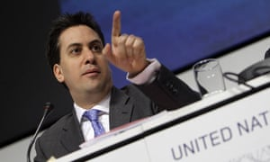 Ed Miliband gestures during a press briefing at the UN climate summit in Copenhagen