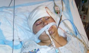 In this photo provided by Crystal Dillman, Luis Ramirez lies in his hospital bed hours before he died. Photograph: AP