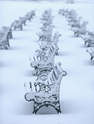 Snow in the UK: Snow covers benches on The Lawn at Ascot Racecourse