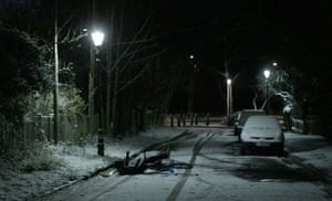 Snow in the UK: A paperboy falls from his bike after snowfall in London