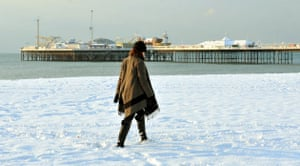 Snow in the UK: Nancy Stillwell from Essex, walks along the snow covered beach in Brighton
