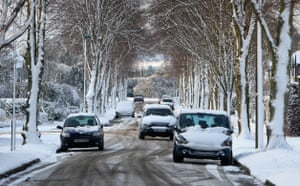 Snow in the UK: Cars are covered with snow in Carshalton Beeches