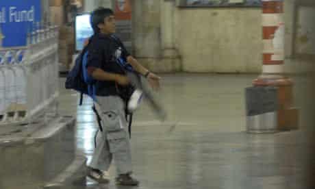 Mohammed Ajmal Kasab, walks through Chatrapathi Sivaji Terminal railway station in Mumbai, India