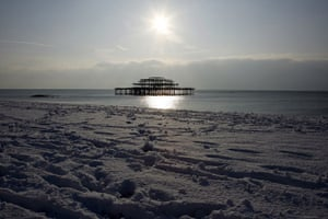 Snow in the UK: Snow covers the West Pier on Brighton beach