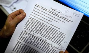 A journalist reads the latest draft of the Copenhagen Accord at the climate summit
