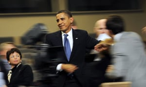 Barack Obama as he walks through the press conference room at the Bella Centre