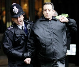 Peter Tatchell: Gay Rights activist Peter Tatchell is escorted by a policeman