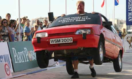worlds strongest man lifting cars