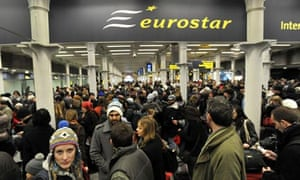 Passengers wait at St Pancras Station in London after delays to the Eurostar train services.