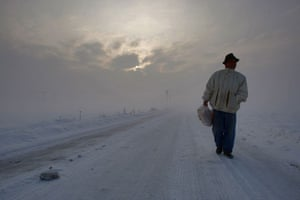 Snow around the world: Bosnian Mirko Savic walks on a snow covered road near Doboj