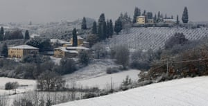 Snow around the world: A winter view of the Tuscan countryside on the outskirts of Siena, Italy
