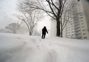 Snow around the world: A woman makes her way home under heavy snow fall in Maryland, US