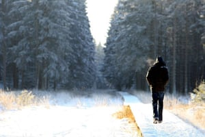 Snow around the world: Jalhay, Belgium: A man walks at the Botrange plateau