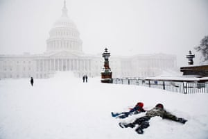 Snow around the world: Washington DC, US: Children make snow angels in front of the US Capitol