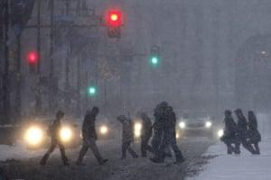 Snow around the world: Philadelphia, US: People walk across Broad Street through the snow
