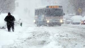 Snow around the world: Washington DC, US: A Washington Metrobus navigates the hill on 13th Street