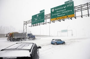 Snow around the world: Arlington, Virginia, US: A snow plough truck works to clear the road