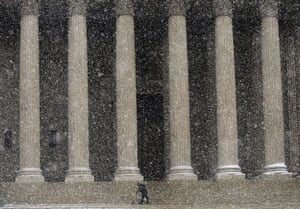 Snow around the world: Washington DC, US:  A worker clears snow from steps of the Supreme Court