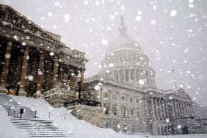 Snow around the world: Washington DC, US: The US Capitol is nearly obscured as heavy snow falls