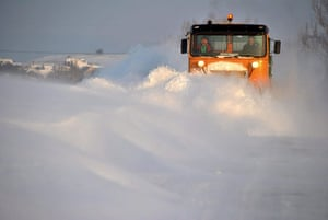 Snow: Hungary: A snow plough works to clear a road southwest of Budapest