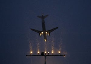 Snow: Germany: A plane comes in to land during heavy snowfall at Hanover airport