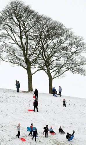Snow: UK: Children and adults enjoy the snow at Lyme Park in Disley, Stockport