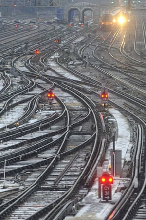 travel chaos: A train travels along snow covered lines at Clapham Junction
