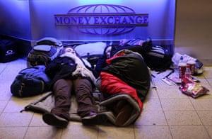 Travel chaos: Passengers sleep at Luton airport