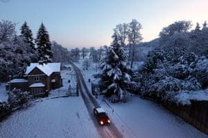 Travel chaos: A car negotiates a snowy lane in Luton