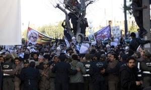 Iranisn police hold back Montazeri mourners