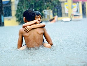 Photographs of the year: Filipino boy floodwaters