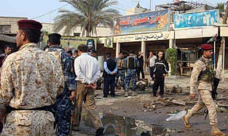 Officials at the scene of the bombing in Hillah