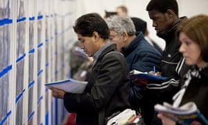 Job seekers at a Graduate Recruitment Fair in April