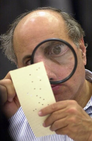 Pictures of the Decade: 24 November 2000: A judge examines a disputed US election ballot in Florida