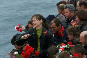 Pictures of the Decade: 24 August 2000: Relatives of the crew of the submarine Kursk throw flowers