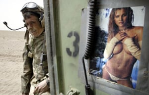Science 2009: Marine Standing by Vehicle Decorated with Pinup Poster