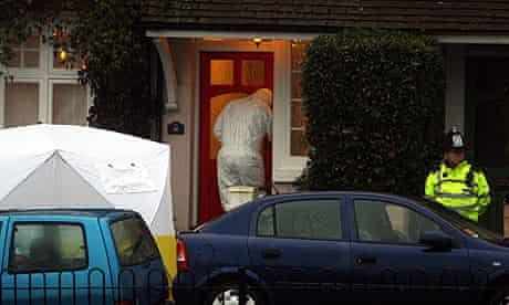 Police and forensic officers at the scene of the shooting in Aldershot